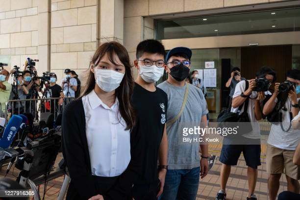 Pro-democracy activist Agnes Chow Ting , Joshua Wong and Ivan Lam Long-yin speak to the press outside the court fon illegal assembly charges in...