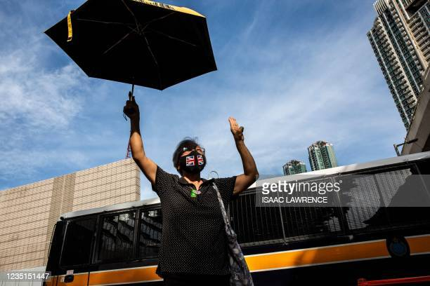 Pro-democracy activist Alexandra Wong, also known as Grandma Wong, gestures outside West Kowloon court in Hong Kong on September 10 as standing...
