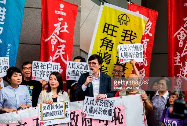 Prodemocracy activist Avery Ng accompanied by former lawmaker Lau Siulai and lawmaker Claudia Mo speaks during a protest against the Hong Kong police...