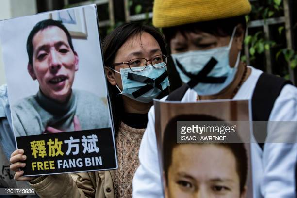 A prodemocracy activist from HK Alliance holds a placard of missing citizen journalist Fang Bin as she protests outside the Chinese liaison office in...
