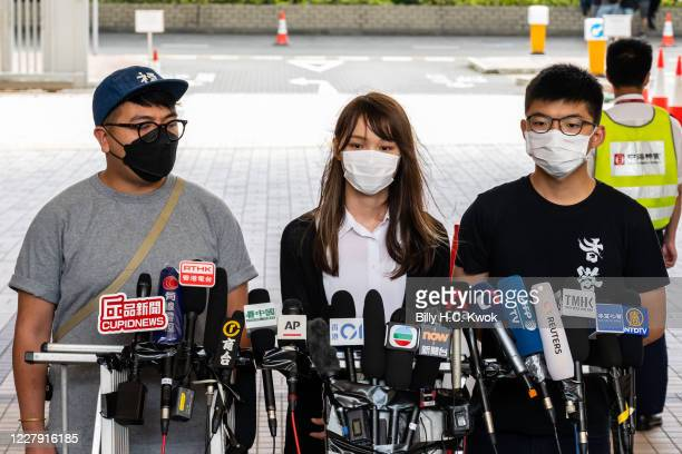 Pro-democracy activist Ivan Lam Long-yin , Agnes Chow Ting and Joshua Wong speak to the press outside the court regarding illegal assembly charges in...
