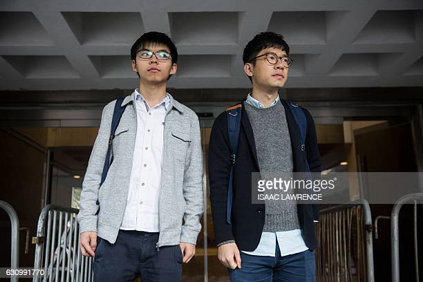 Pro-democracy activist Joshua Wong and Legislative Council member Nathan Law, both from the Demosisto party, stop for the media after leaving High...