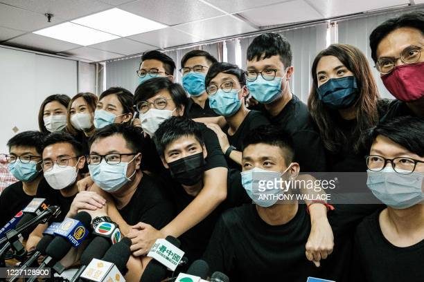 Pro-democracy activist Joshua Wong and other winners of the unofficial democratic primaries pose at the end of a press conference in Hong Kong on...