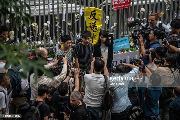 Prodemocracy activist Joshua Wong holds a protest poster as he speaks to members of the media outside the Legislative Council building following a...