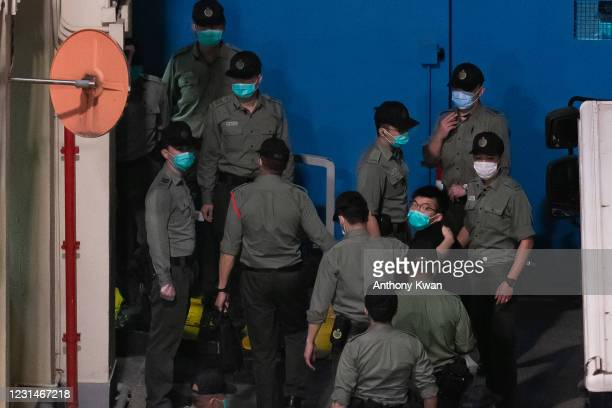 Pro-democracy activist Joshua Wong is escorted into the Lai Chi Kok Reception Centre after exiting a Correctional Service Department van on March 2,...