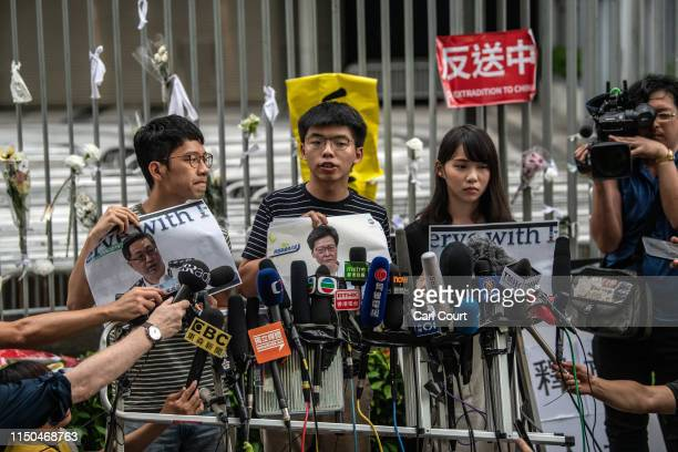 Pro-democracy activist Joshua Wong speaks to members of the media outside the Legislative Council building following a press conference by Hong Kong...