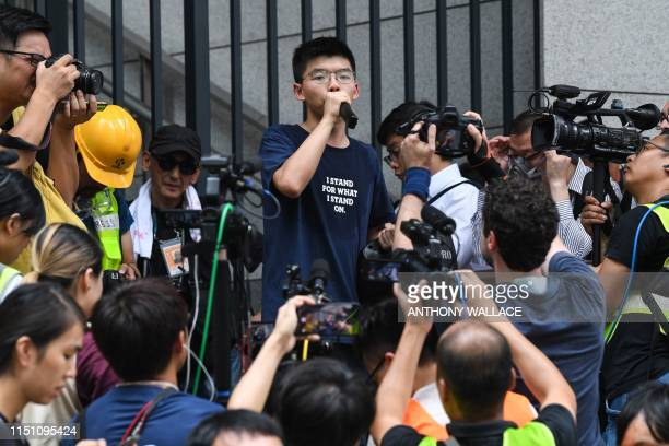 Pro-democracy activist Joshua Wong speaks to protesters outside the police headquarters in Hong Kong on June 21, 2019. - Hundreds poured into Hong...