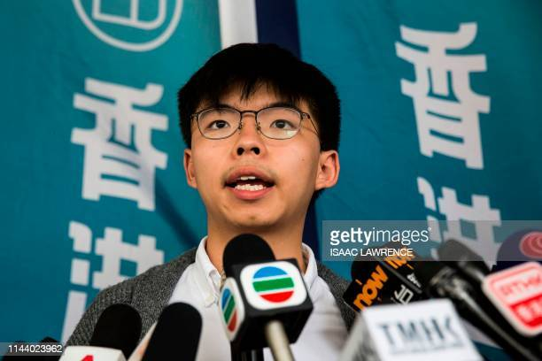 Pro-democracy activist Joshua Wong speaks to the media in front of the high court in Hong Kong on May 16 before judgement is handed down on his...