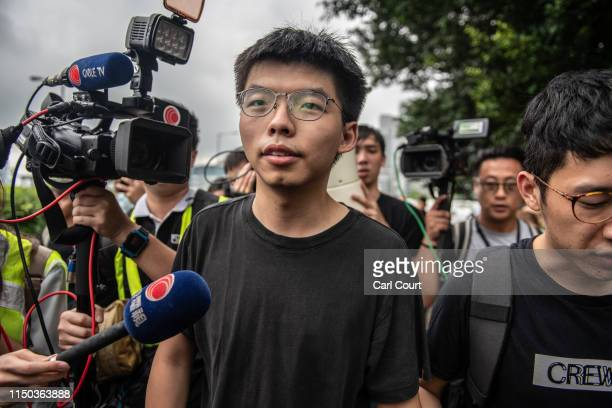 Pro-democracy activist Joshua Wong speaks to the media outside the Legislative Council shortly after being released from prison on June 17, 2019 in...
