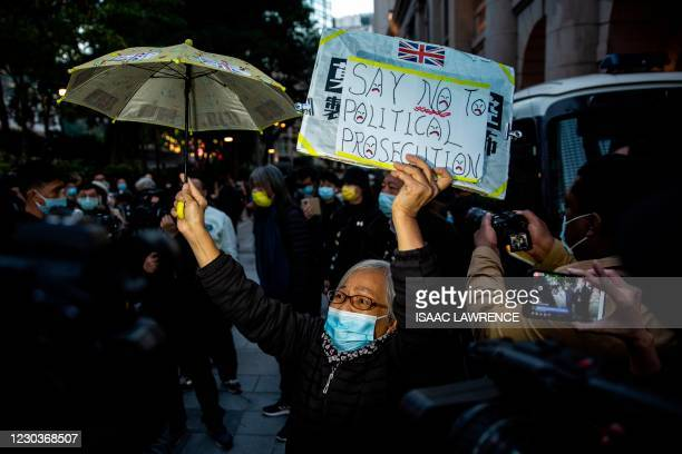 Pro-democracy activist known as grandma Wong shows her support for media tycoon Jimmy Lai at the Court of Final Appeal in Hong Kong on December 31...