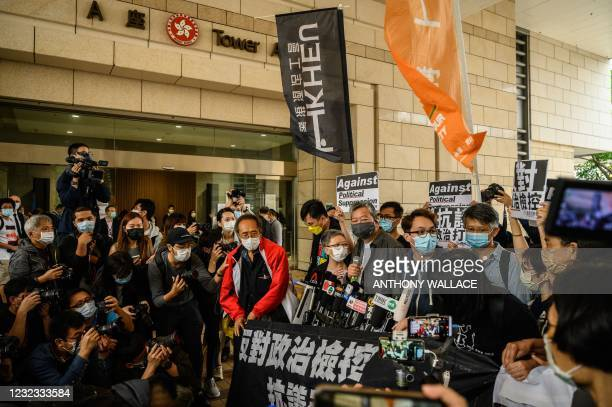 Pro-democracy activist Lee Cheuk-yan arrives at West Kowloon court in Hong Kong on April 16 to receive sentencing after being found guilty of...