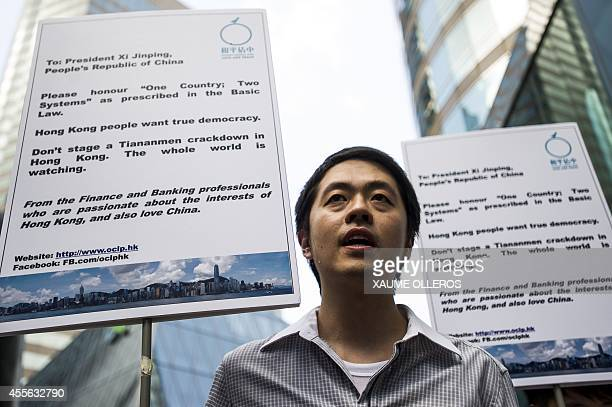 A prodemocracy activist sings during a rally by Occupy Central's banking and finance group outside the stock exchange building in Hong Kong on...