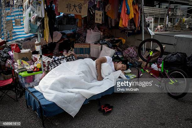 A prodemocracy activist sleeps in the early hours of the morning outside Hong Kong's Government complex on October 10 2014 in Hong Kong Hong Kong...