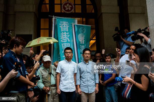 Pro-democracy activists and Demosisto members Joshua Wong and Nathan Law speak to the media outside the Court of Final Appeal after their bail...