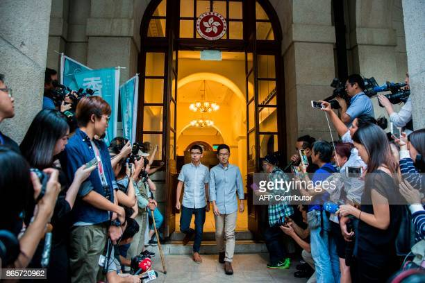 Pro-democracy activists and Demosisto members Joshua Wong and Nathan Law walk from the Court of Final Appeal after their bail applications were...