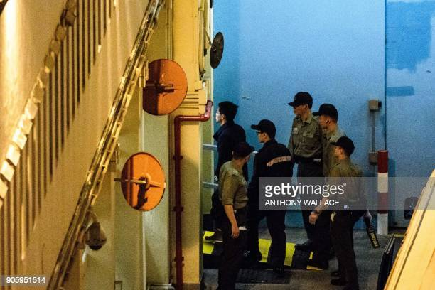 Prodemocracy activists and Joshua Wong and Raphael Wong arrive at Lai Chi Kok Reception Centre after they were jailed on protest related charges...