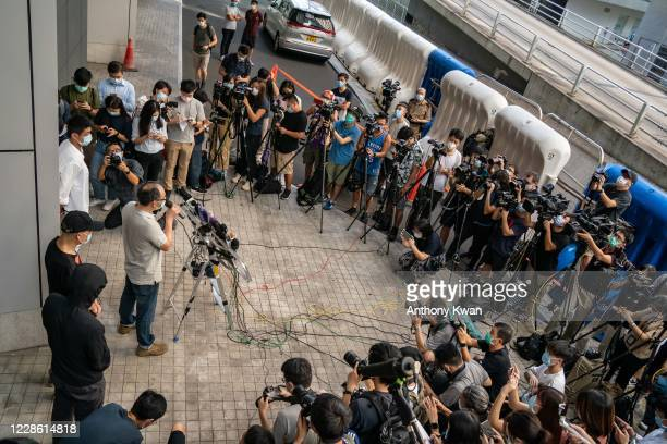 Pro-democracy activists Eddie Chu and Owen Chow speaks to members of media alongside with some of the family members of the 12 Hong Kong activists,...