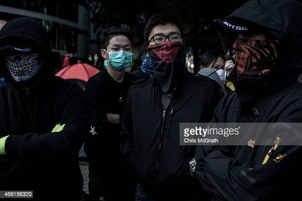 Pro-democracy activists gather around barricades on the road outside Citic Tower on November 18, 2014 in Hong Kong, Hong Kong. Baliffs oversaw the...