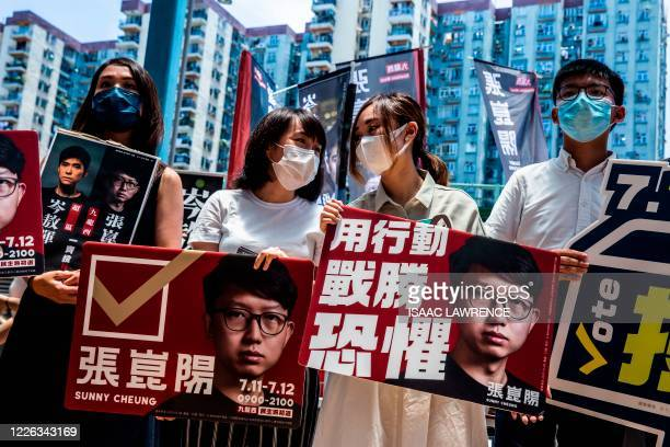 Pro-democracy activists Gwyneth Ho, Leung Hoi-ching, Tiffany Yuen and Joshua Wong campaign during primary elections in Hong Kong on July 12, 2020. -...
