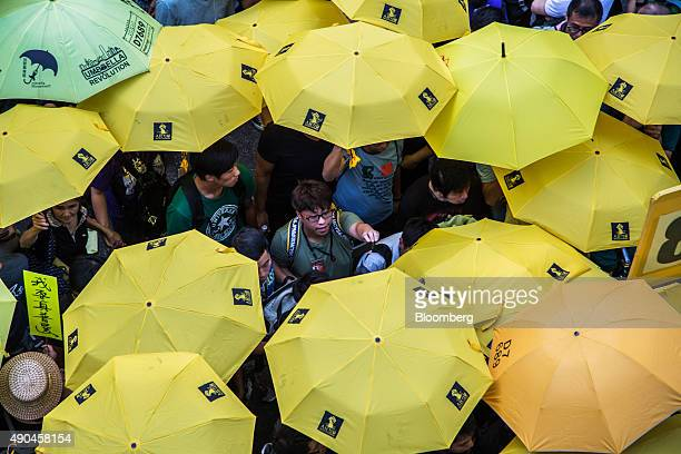Prodemocracy activists hold yellow umbrellas as they gather outside of the Hong Kong Government Complex in the Admiralty district of Hong Kong China...