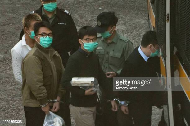 Pro-democracy activists Joshua Wong and Ivan Lam board a Hong Kong Correctional Service van ahead of a sentence hearing at Lai Chi Kok Reception...