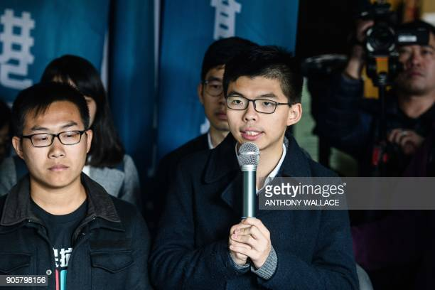 Prodemocracy activists Joshua Wong and Raphael Wong speak to the press before entering the High Court to hear their sentences on protest related...