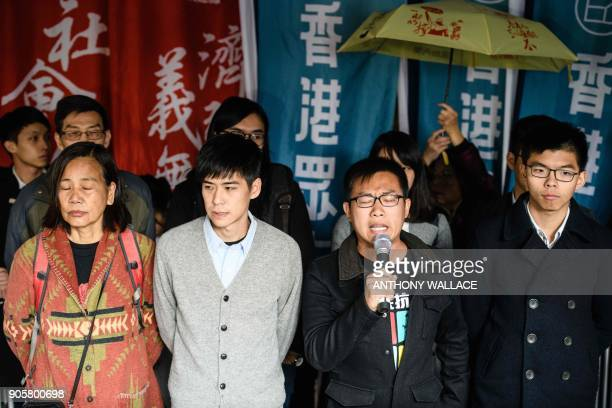 Prodemocracy activists Joshua Wong Raphael Wong and Lester Shum speak to the press before entering the High Court to hear their sentences on protest...