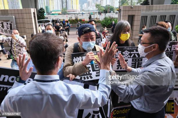 Pro-democracy activists Lee Cheuk-yan and Leung Kwok Hung are stopped by security as they demonstrate outside the West Kowloon Magistrates' Court. 26...