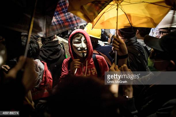 Pro-democracy activists put up umbrellas as they stand off with police outside the Legislative Council building on November 19, 2014 in Hong Kong....