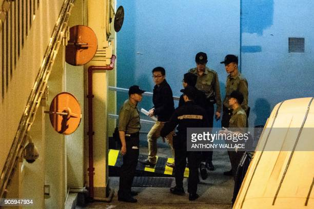 Prodemocracy activists Raphael Wong and Joshua Wong arrive at Lai Chi Kok Reception Centre after they were jailed on protest related charges...