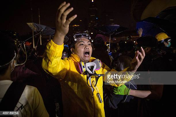 Pro-democracy activists screams for reinforcements as they clash with police outside the Legislative Council building on November 19, 2014 in Hong...