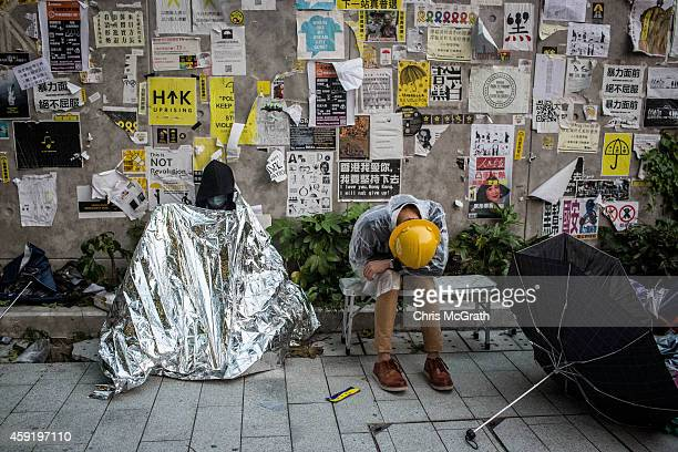 Pro-democracy activists sleep outside the Legislative Council building after protesters clashed with police on November 19, 2014 in Hong Kong....