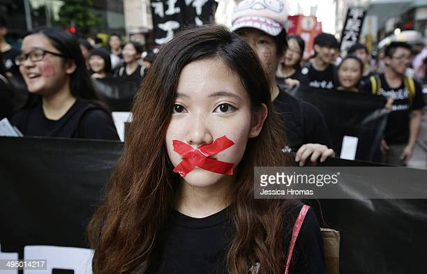 Prodemocracy activits march to mark the 25th anniversary of Tiananmen Square massacre on June 1 2014 in Hong Kong The protest winds it's way from...