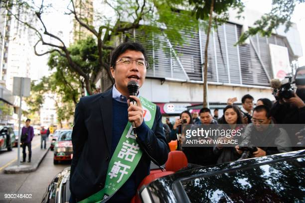 Prodemocracy byelection candidate Au Nokhin stands in his car as he campaigns for the Legislative Council byelections in Hong Kong on March 11 2018...