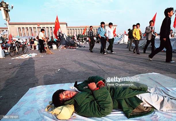 A prodemocracy demonstrator lies sleeping in Tiananmen Square Prodemocracy demonstrators and protestors filled the square for weeks prior to the...