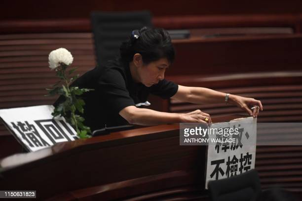 Prodemocracy lawmaker Claudia Mo attaches a note that reads Release Dont Prosecute after she and other prodemocracy lawmakers hold five minutes of...
