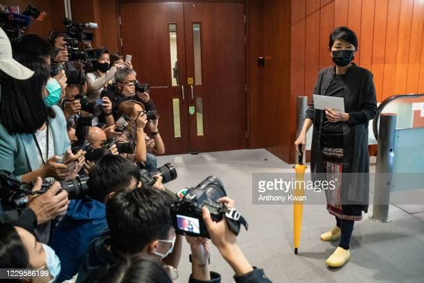 Pro-democracy lawmaker Claudia Mo Man-ching arrives at the Legislative Council to tender her letter of resignation on November 12, 2020 in Hong Kong,...