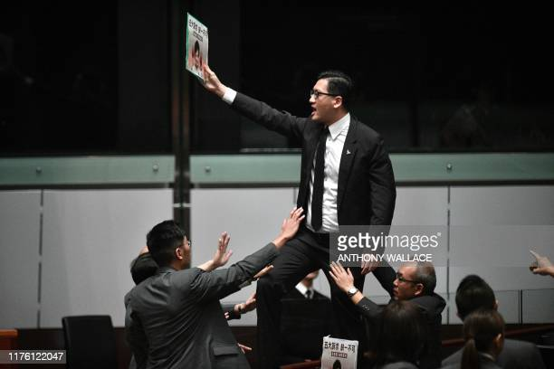 TOPSHOT Prodemocracy lawmaker Lam Cheukting stands up and protests shortly before Hong Kong's Chief Executive Carrie Lam leaves the chamber for the...