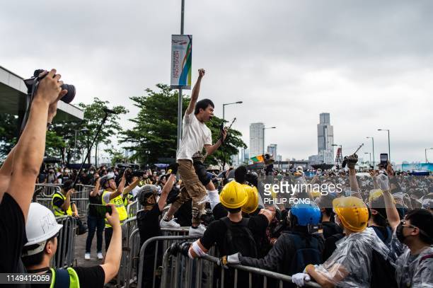 TOPSHOT Prodemocracy lawmaker Roy Kwong chants slogans as protesters occupy outside Legislative Council in Hong Kong on June 12 2019 Large crowds of...