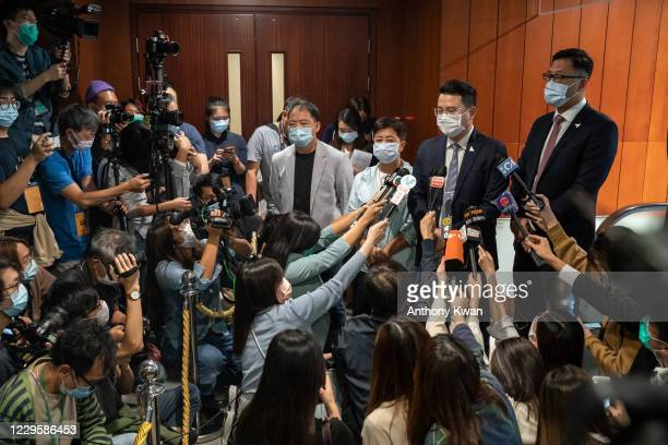 Pro-democracy lawmakers Helena Wong, Wu Chi-wai, Andrew Wan Siu-kin and Lam Cheuk-ting speaks to members of media after tendering their letters of...