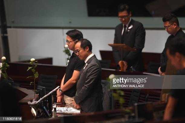 Prodemocracy lawmakers hold five minutes of silence in the Legislative Council in Hong Kong on June 19 for a man who fell to his death on June 15...