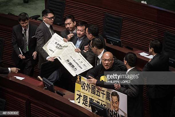 Prodemocracy lawmakers Raymond Chan and Albert Chan are taken away after they interrupted the policy address of Hong Kong Chief Executive Leung...