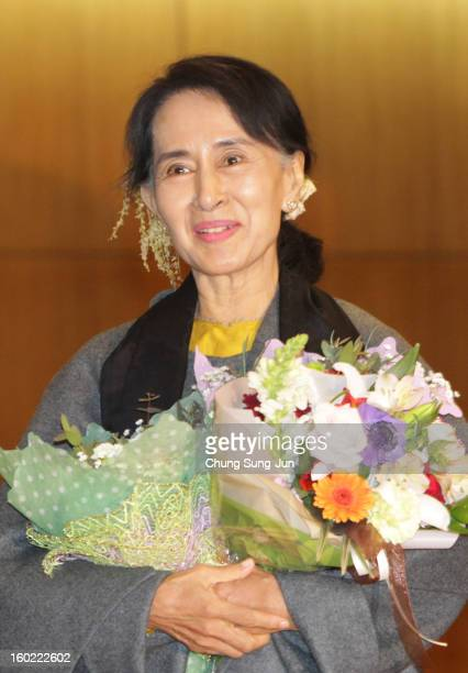 Prodemocracy leader Aung San Suu Kyi arrives at Incheon International Airport on January 28 2013 in Incheon South Korea Myanmar opposition party...