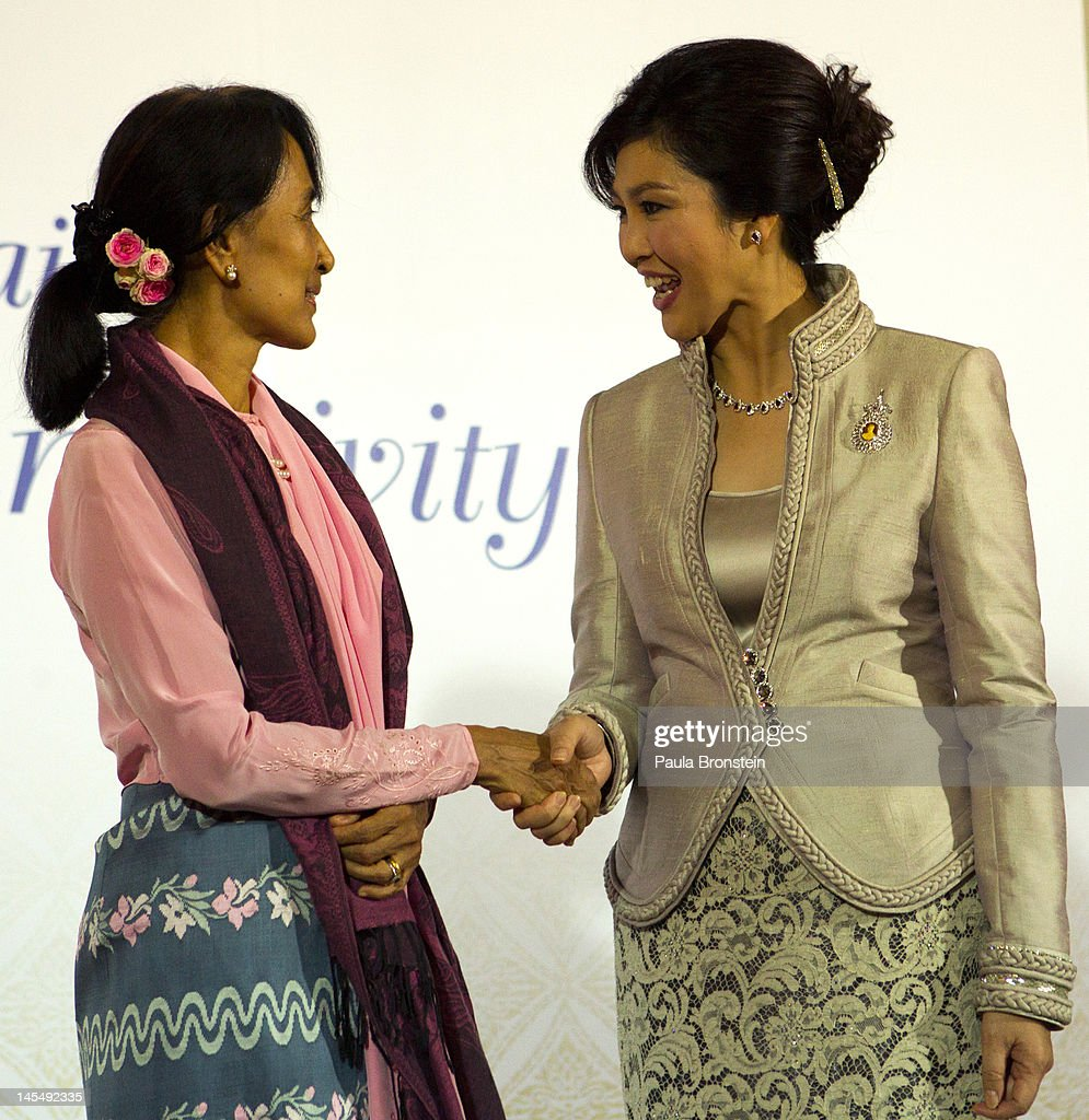 Aung san suu kyi attends gala in thailand photos and images getty pro democracy leader aung san suu kyi greets thailands prime minister yingluck shinawatra r kristyandbryce Choice Image