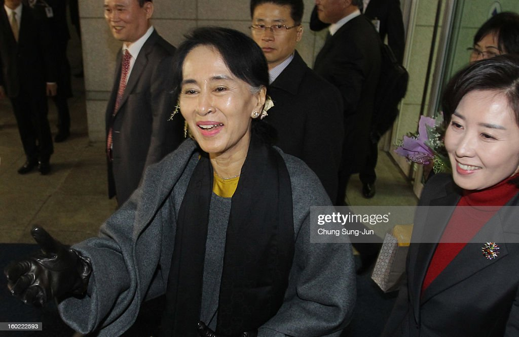Pro-democracy leader Aung San Suu Kyi shakes hands with members of the National League for Democracy at Incheon International Airport on January 28, 2013 in Incheon, South Korea. Myanmar opposition party leader and Nobel Peace Prize laureate arrived in South Korea for a 5-day visit