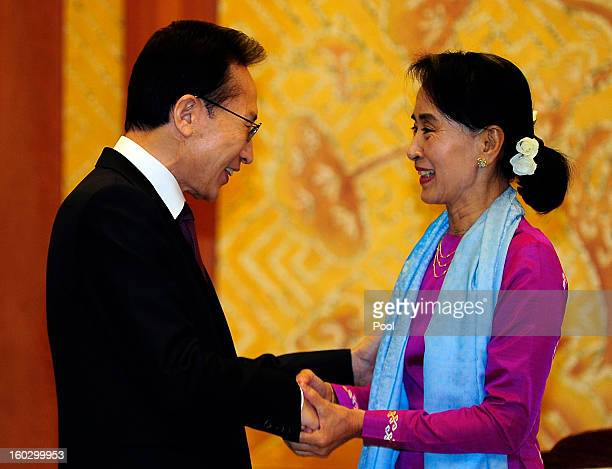 Prodemocracy leader Aung San Suu Kyi shakes hands with South Korean President Lee MyungBak during their meeting at the presidential house on January...