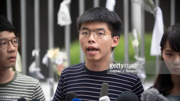 Pro-democracy party activists Nathan Law, Joshua Wong and Agnes Chow speak to the media outside the legislative Council building after Chief...