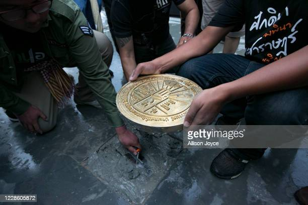 Pro-democracy protest leaders place a plaque on Sanam Luang field during a rally on September 20, 2020 in Bangkok, Thailand. Thousands of...