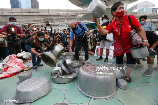 Pro-democracy protester banging a saucepan during a rally demanding the prime minister to resign and reforms in the monarchy. Thousands of...