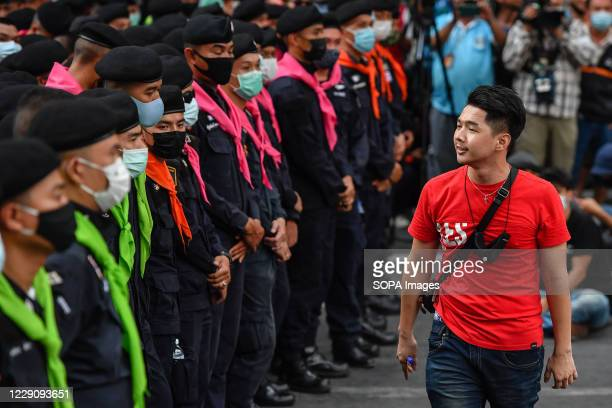 Pro-democracy protester confronts police officers at Ratchaprasong interjection central of Bangkok during the demonstration. Thousands of Thai...